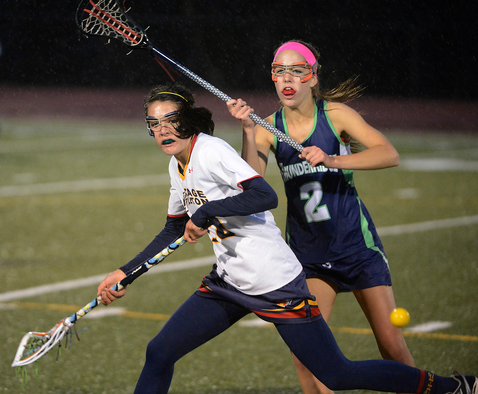 . LITTLETON, CO - MAY 8: Jessy Kelly, Heritage/Littleton, left, and Lindsey Givin, ThunderRidge High School, go after a loose ball during the second half of play at Littleton Public Schools Stadium for the first round of the 2013 Colorado Girls State Lacrosse Championships May 8, 2013. ThunderRidge won 8-5. (Photo By Andy Cross/The Denver Post)