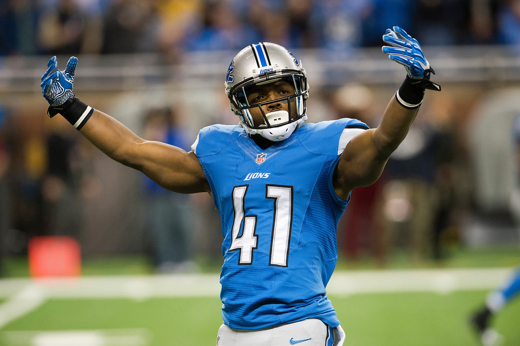 . Running back Theo Riddick #41 of the Detroit Lions tries to rev up the crown prior to kick off against the Baltimore Ravens during the first half at Ford Field on December 16, 2013 in Detroit, Michigan. (Photo by Jason Miller/Getty Images)