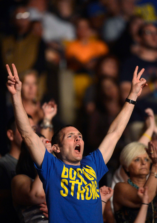 . Concert goers react to hearing Boston Bombing survivor Victoria McGrath address the crowd during the Boston Strong benefit concert at the Boston TD Garden in Boston, May 30, 2013.  REUTERS/Gretchen Ertl