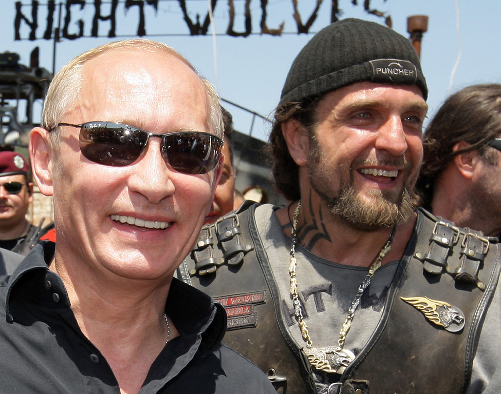 ". A picture taken on July 24, 2010, shows Vladimir Putin (L), then Russia\'s Prime Minister, walking side by side with Alexander Zaldostanov (L), nicknamed ""the Surgeon\"", the leader of the group of Russian bikers called the Night Wolves, as they meet Russian and Ukrainian motorbikers at their camp near Sevastopol in Ukraine\'s Crimea. The Night Wolves arrived today in  Ukraine\'s Crimea to back pro-Russian protests. AFP PHOTO / RIA NOVOSTI / POOL / ALEXEY  DRUZHININ/AFP/Getty Images"