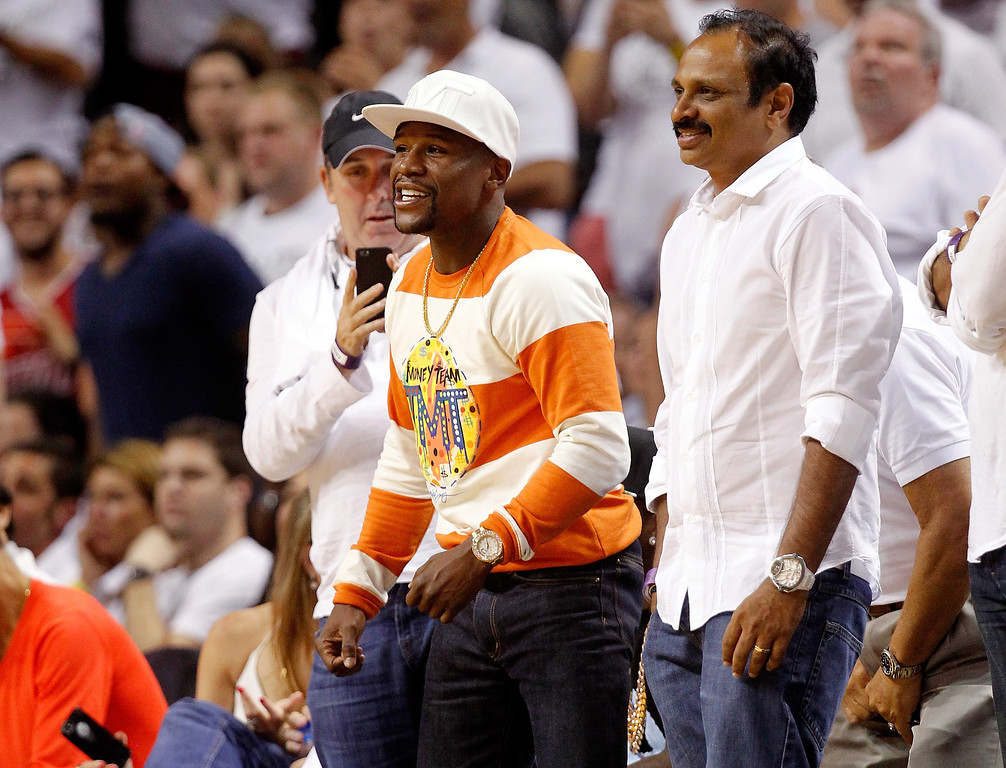 . Boxer Floyd Mayweather Jr. attends Game Four of the Eastern Conference Finals of the 2014 NBA Playoffs between the Miami Heat and the Indiana Pacers at American Airlines Arena on May 26, 2014 in Miami, Florida.  (Photo by Mike Ehrmann/Getty Images)