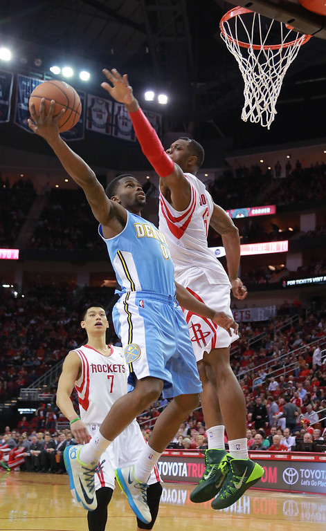 . Denver Nuggets guard Aaron Brooks puts up a shot against Houston Rockets forward Terrence Jones during the first half of an NBA basketball game in Houston on Sunday, April 6, 2014. (AP Photo/Richard Carson)