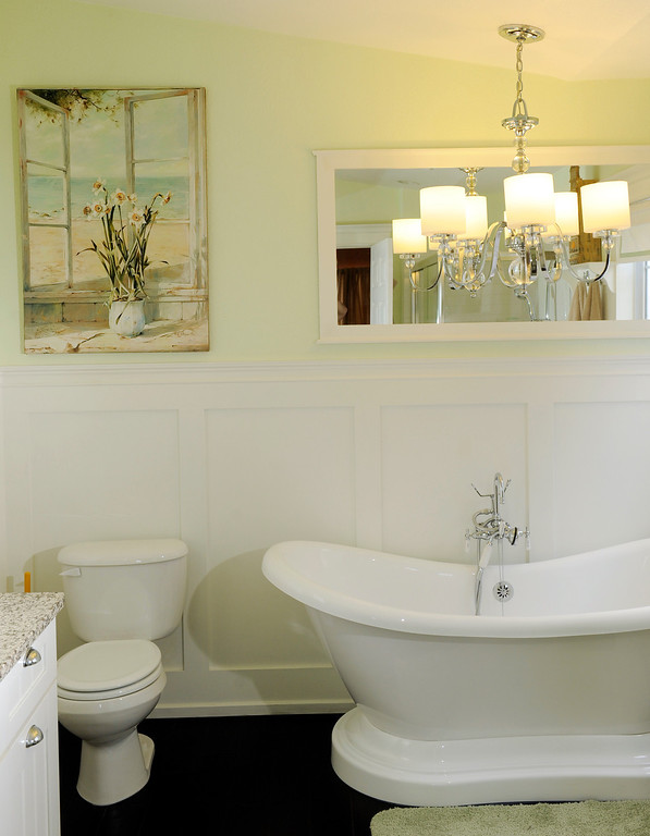 . One of Lewis\' directives for his lakeside condo was coastal references, so a painting of a vase in front of a beachside window brought the concept to the bathroom. (Photo By Cyrus McCrimmon/The Denver Post)