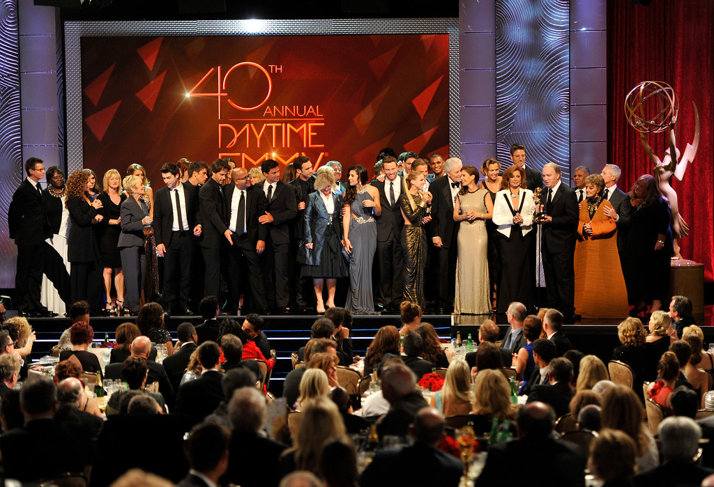 ". The cast and crew of ""Days of Our Lives\"" accept the award for outstanding drama series at the 40th Annual Daytime Emmy Awards on Sunday, June 16, 2013, in Beverly Hills, Calif. (Photo by Chris Pizzello/Invision/AP)"