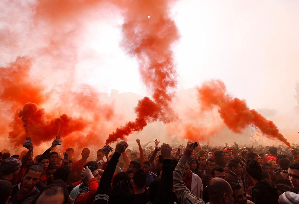 ". Al-Ahly fans, also known as ""Ultras\"", shout slogans against the Interior Ministry in front of the Al-Ahly club after hearing the final verdict of the 2012 Port Said massacre in Cairo March 9, 2013.  REUTERS/Amr Abdallah Dalsh"