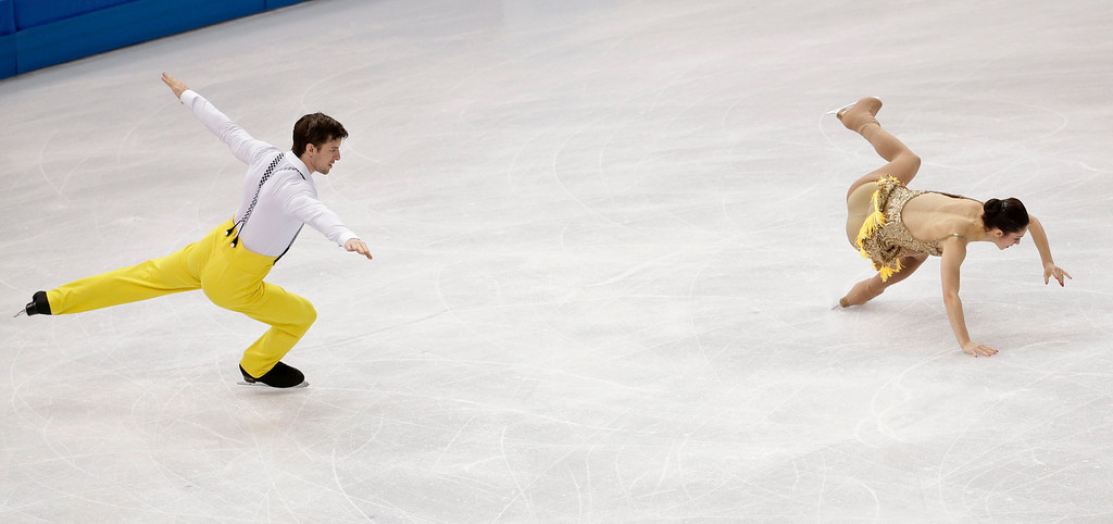 Description of . Stefania Berton falls as she and Ondrej Hotarek of Italy compete in the pairs short program figure skating competition at the Iceberg Skating Palace during the 2014 Winter Olympics, Tuesday, Feb. 11, 2014, in Sochi, Russia. (AP Photo/Bernat Armangue)