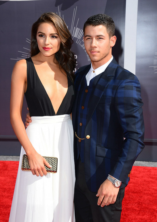 . Olivia Culpo, left, and Nick Jonas arrive at the MTV Video Music Awards at The Forum on Sunday, Aug. 24, 2014, in Inglewood, Calif. (Photo by Jordan Strauss/Invision/AP)