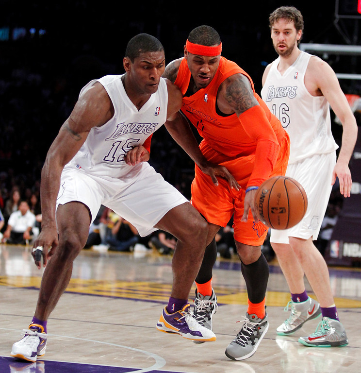 . New York Knicks forward Carmelo Anthony, center, battles Los Angeles Lakers forward Metta World Peace, left, for the ball as forward Pau Gasol, right, of Spain, watches during the second half of their NBA basketball game in Los Angeles, Tuesday, Dec. 25, 2012. The Lakers won 100-94. (AP Photo/Alex Gallardo)