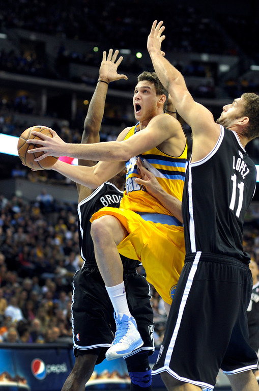 . DENVER, CO. - MARCH 29: Danilo Gallinari (8) of the Denver Nuggets drove between Gerald Wallace (45) and Brook Lopez (11) of the Brooklyn Nets in the first half. The Denver Nuggets hosted the Brooklyn Nets Friday night, March 29, 2013 at the Pepsi Center in Denver.  (Photo By Karl Gehring/The Denver Post)