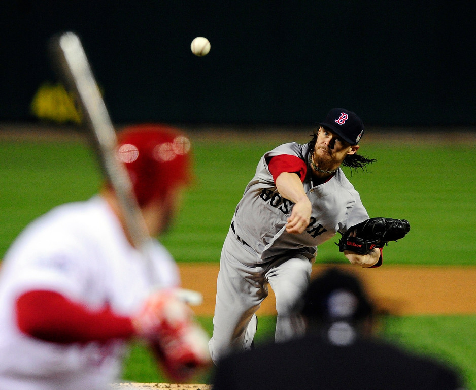 . Boston Red Sox starting pitcher Clay Buchholz throws during the first inning of Game 4 of baseball\'s World Series against the St. Louis Cardinals  Sunday, Oct. 27, 2013, in St. Louis. (AP Photo/Jeff Curry, Pool)