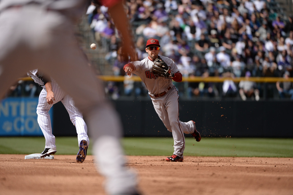 . Diamondbacks 2nd baseman Aaron Hill makes a double play during the first inning, taking out Rockies runners Michael Cuddyer and Carlos Gonzalez.  (Photo by Hyoung Chang/The Denver Post)