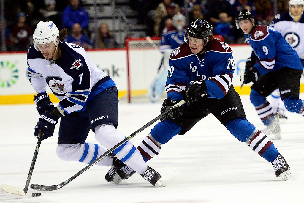 . Nathan MacKinnon (29) of the Colorado Avalanche defends Keaton Ellerby (7) of the Winnipeg Jets during the first period of action.  (Photo by AAron Ontiveroz/The Denver Post)