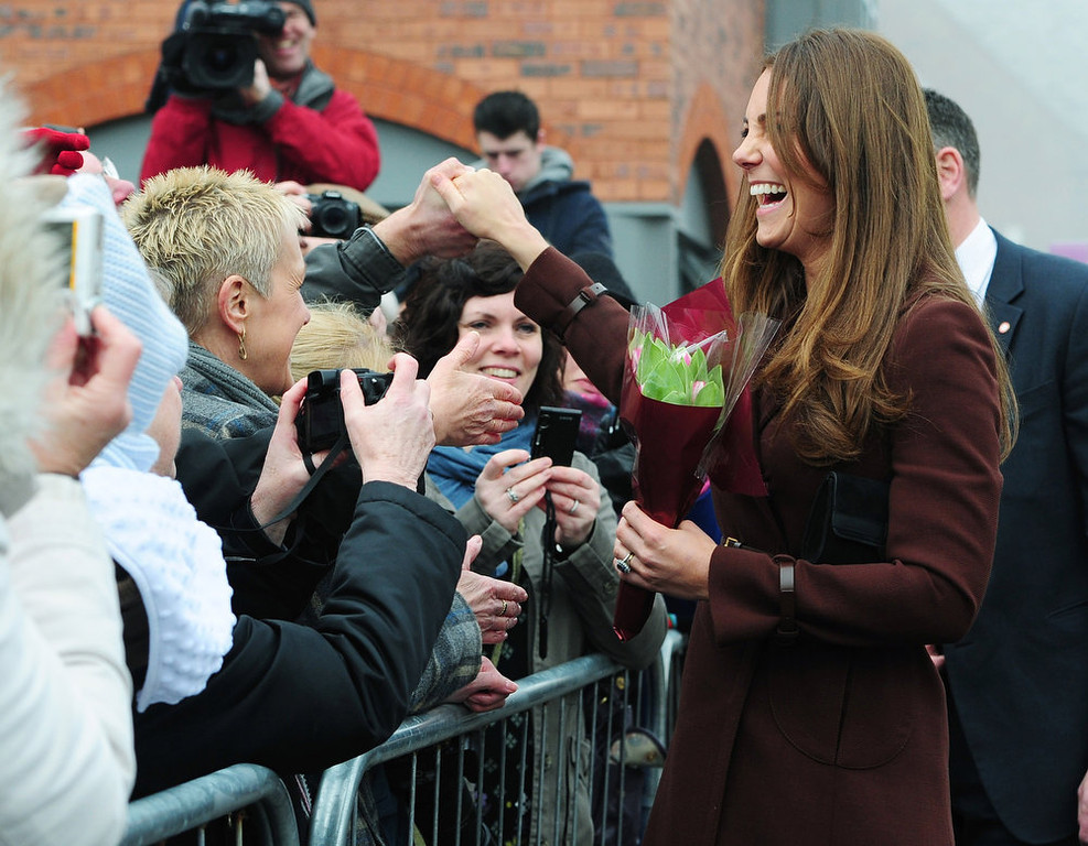 . Catherine, The Duchess of Cambridge greets well-wishers during her visit outside the National Fishing Heritage Centre on March 5, 2013 in Grimsby, England.  (Photo Anna Gowthorpe - WPA Pool/Getty Images)