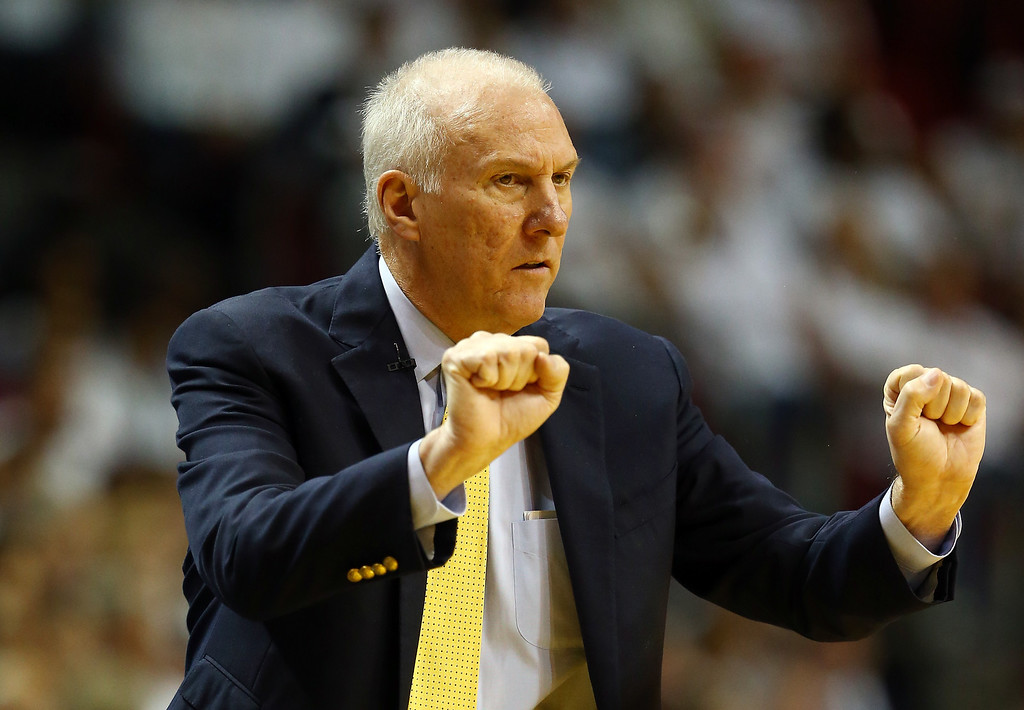 . MIAMI, FL - JUNE 12:  Gregg Popovich of the San Antonio Spurs motions to his players against the Miami Heat during Game Four of the 2014 NBA Finals at American Airlines Arena on June 12, 2014 in Miami, Florida. (Photo by Andy Lyons/Getty Images)