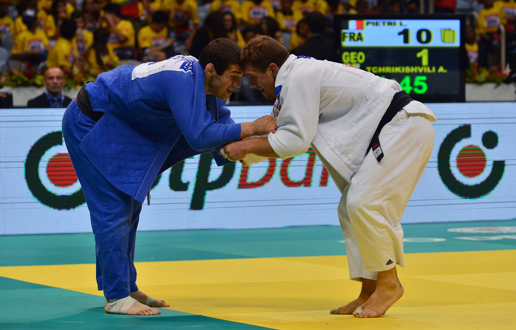. France\'s Loic Pietri (R) and Georgia\'s Avtandili Tchrikishvili compete in the the men\'s -81kg category final, during the IJF World Judo Championship, in Rio de Janeiro, Brazil, on August 29, 2013. YASUYOSHI CHIBA/AFP/Getty Images
