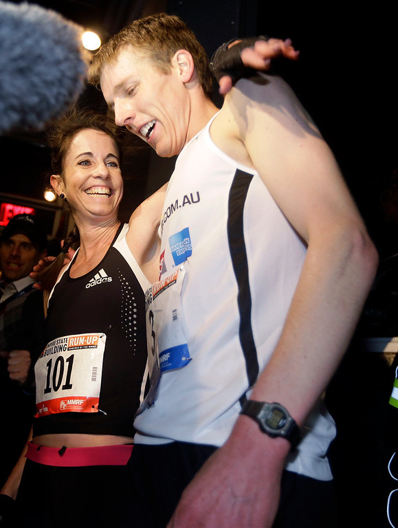 . Suzy Walsham, right, and Mark Bourne, both of Australia, celebrate after their victories in the Empire State Building Run-Up, Wednesday, Feb. 6, 2013, in New York.  (AP Photo/Frank Franklin II)