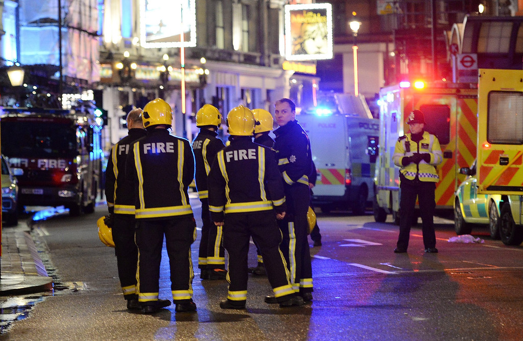 . Rescue services at the scene of an apparent balcony collapse at the Apollo Theatre in London, Britain, 19 December 2013. 20 to 40 people were injured according to first estimates by authorities.  EPA/ANDY RAIN