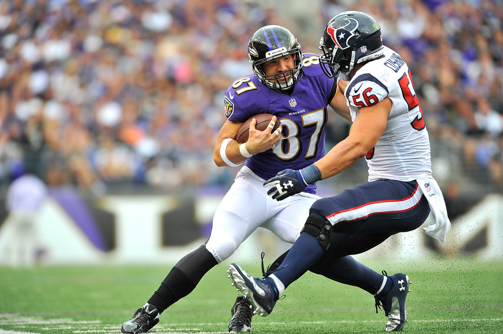 . Tight end Dallas Clark #87 of the Baltimore Ravens runs the ball against inside linebacker Brian Cushing #56 of the Houston Texans at M&T Bank Stadium on September 22, 2013 in Baltimore, Maryland. The Ravens defeated the Texans 30-9. (Photo by Larry French/Getty Images)