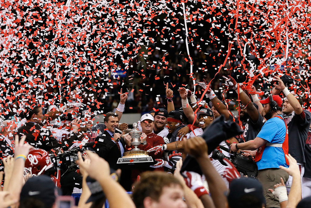 . NEW ORLEANS, LA - JANUARY 02:  Head coach Bob Stoops of the Oklahoma Sooners celebrates with the winner\'s trophy after defeating the Alabama Crimson Tide 45-31 during the Allstate Sugar Bowl at the Mercedes-Benz Superdome on January 2, 2014 in New Orleans, Louisiana.  (Photo by Kevin C. Cox/Getty Images)