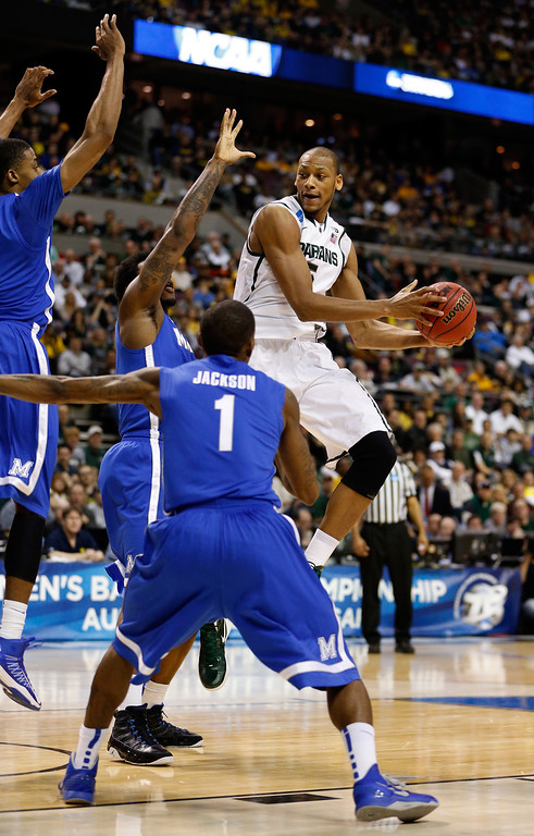 . AUBURN HILLS, MI - MARCH 23:  Adreian Payne #5 of the Michigan State Spartans looks to pas as he drives agianst Joe Jackson #1 of the Memphis Tigers during the third round of the 2013 NCAA Men\'s Basketball Tournament at The Palace of Auburn Hills on March 23, 2013 in Auburn Hills, Michigan.  (Photo by Gregory Shamus/Getty Images)