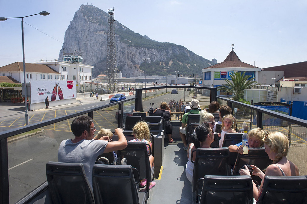 . Tourists ride a bus in Gibraltar on August 13, 2013. This rock of seven square kilometers enclosed in the coast of Andalusia, off the tip of southern Spain, is reminiscent of England: the red phone booths, mailboxes Royal Mail, the lampposts decorated with flowers, and double decker buses.   MARCOS MORENO/AFP/Getty Images