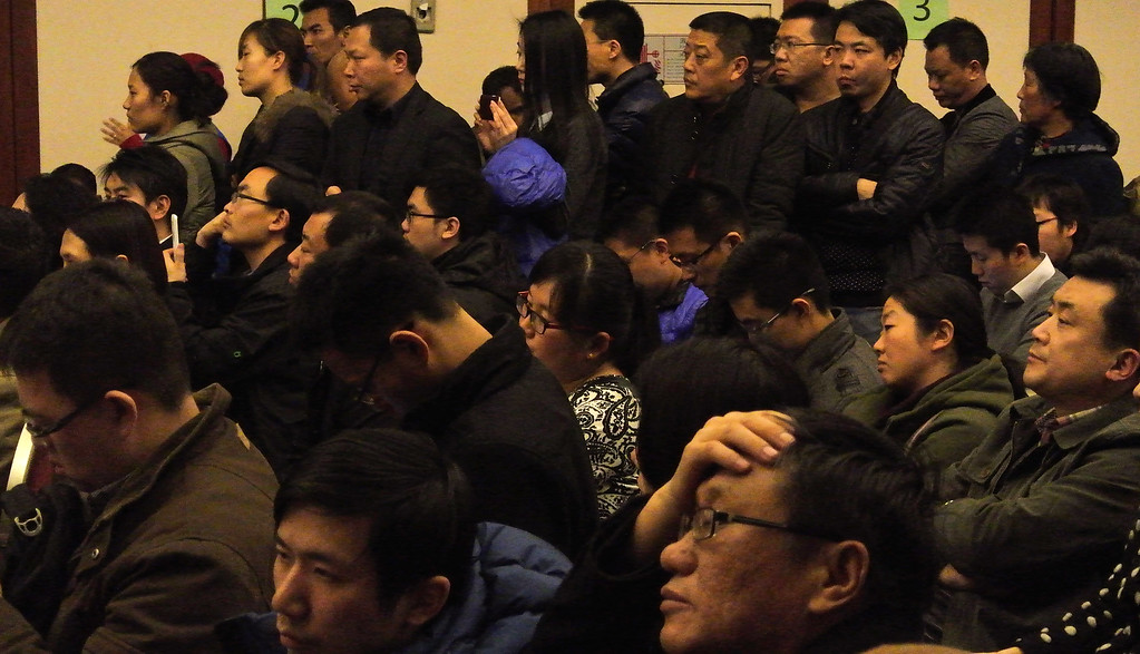 . Chinese relatives of the passengers onboard attend a conference with Malaysia Airlines on March 11, 2014 in Beijing, China. Officials have expanded the search area for missing Malaysia Airlines flight MH370 to include more of the Gulf of Thailand between Malayisa and Vietnam and land along the Malay Peninsula.  (Photo by Lintao Zhang/Getty Images)