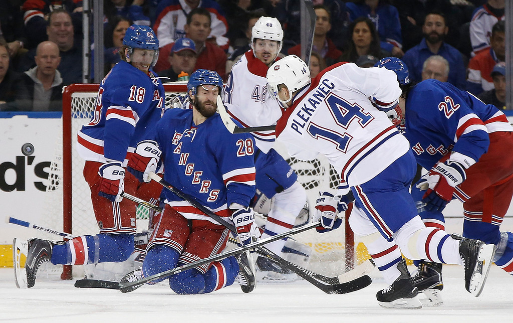 . New York Rangers center Dominic Moore (28) and defenseman Marc Staal (18) block a shot by Montreal Canadiens center Tomas Plekanec (14) during the second period in Game 6 of the NHL hockey Stanley Cup playoffs Eastern Conference finals, Thursday, May 29, 2014, in New York. (AP Photo/Kathy Willens)