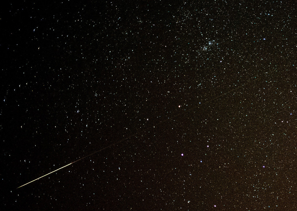 . A shooting star can be seen in the night sky over Sieversdorf, eastern Germany, on August 11, 2013. The peak of the Perseid meteor shower is expected for the night to Tuesday, August 13, 2013. PATRICK PLEUL/AFP/Getty Images