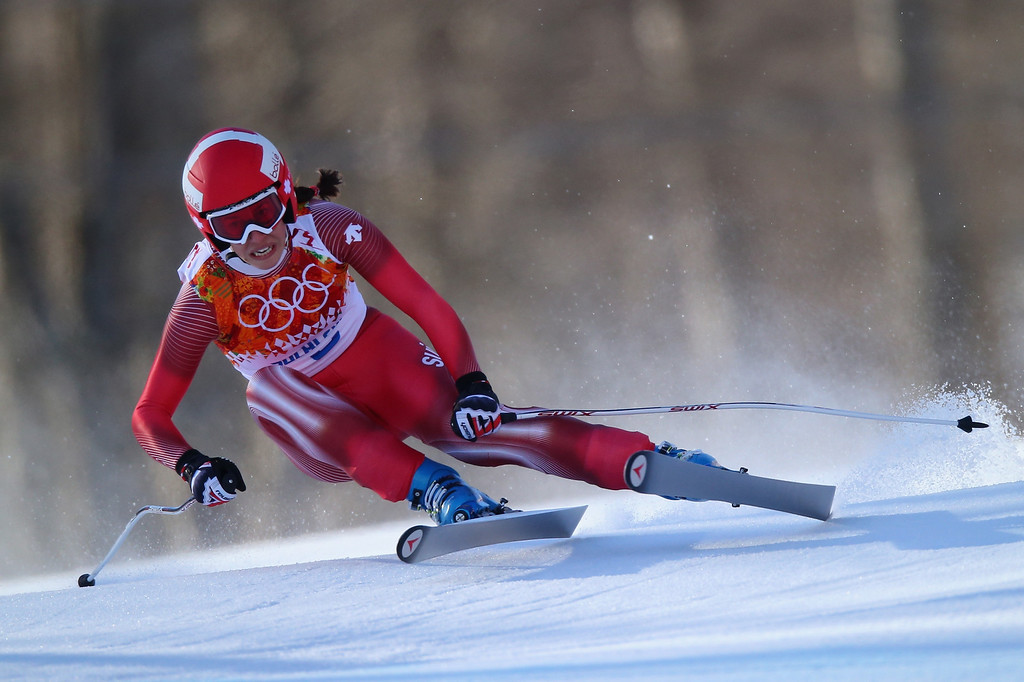 . SOCHI, RUSSIA - FEBRUARY 12: Dominique Gisin of Switzerland skis during the Alpine Skiing Women\'s Downhill on day 5 of the Sochi 2014 Winter Olympics at Rosa Khutor Alpine Center on February 12, 2014 in Sochi, Russia.  (Photo by Clive Rose/Getty Images)
