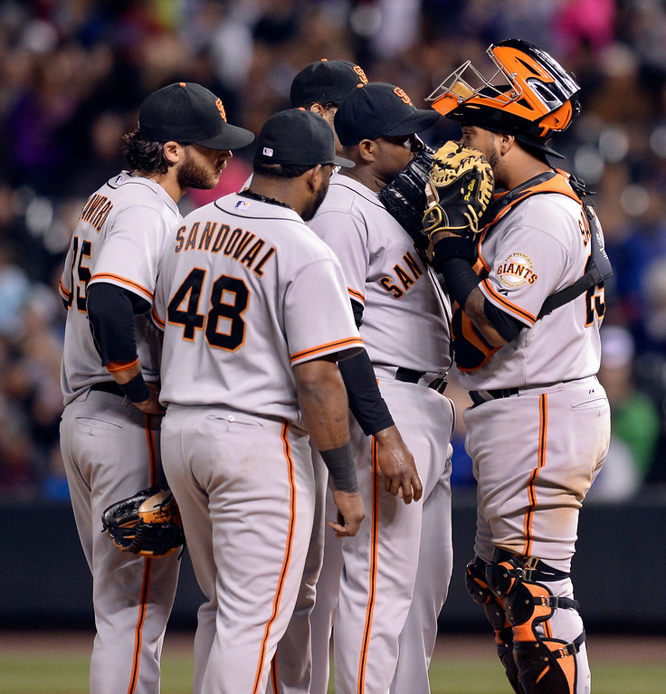 . The San Francisco infield gathered around reliever Santigo Casilla after the Rockies loaded the bases in the eighth inning. The Colorado Rockies hosted the San Francisco Giants Wednesday night, May 21, 2014.  (Photo by Karl Gehring/The Denver Post)