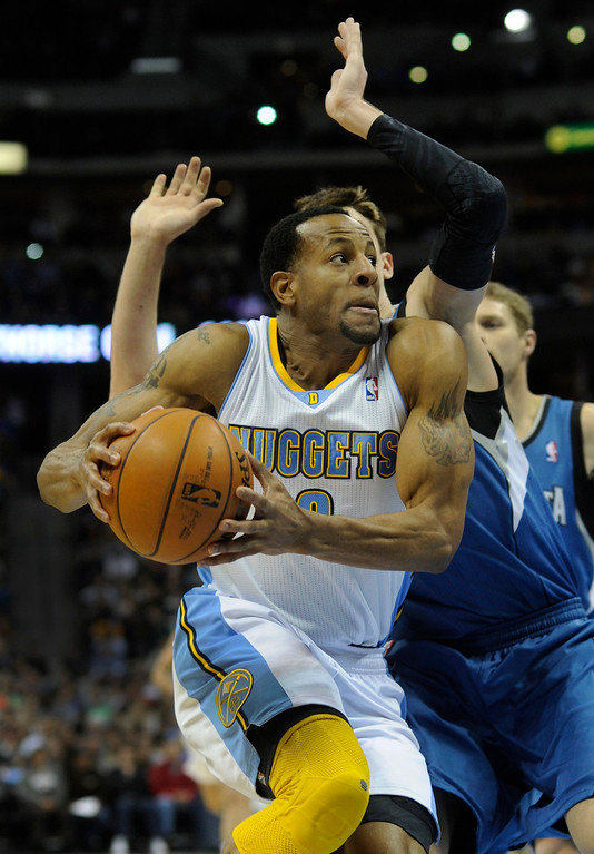 . Denver forward Andre Iguodala (9) made a move past Wolves defender Alexey Shved in the second half. The Minnesota Timberwolves took a bite out of the Denver Nuggets winning 101-97 at the Pepsi Center Thursday night, January 3, 2013. Karl Gehring/The Denver Post