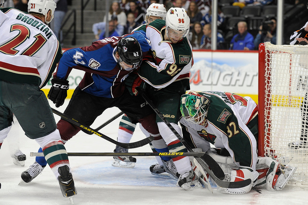 . Minnesota Wild goalie (32) Niklas Backstrom smothers the puck as Brad Malone (42) of the Colorado Avalanche crashes the net during the first period, Saturday, April 27, 2012 at Pepsi Center. Seth A. McConnell, The Denver Post