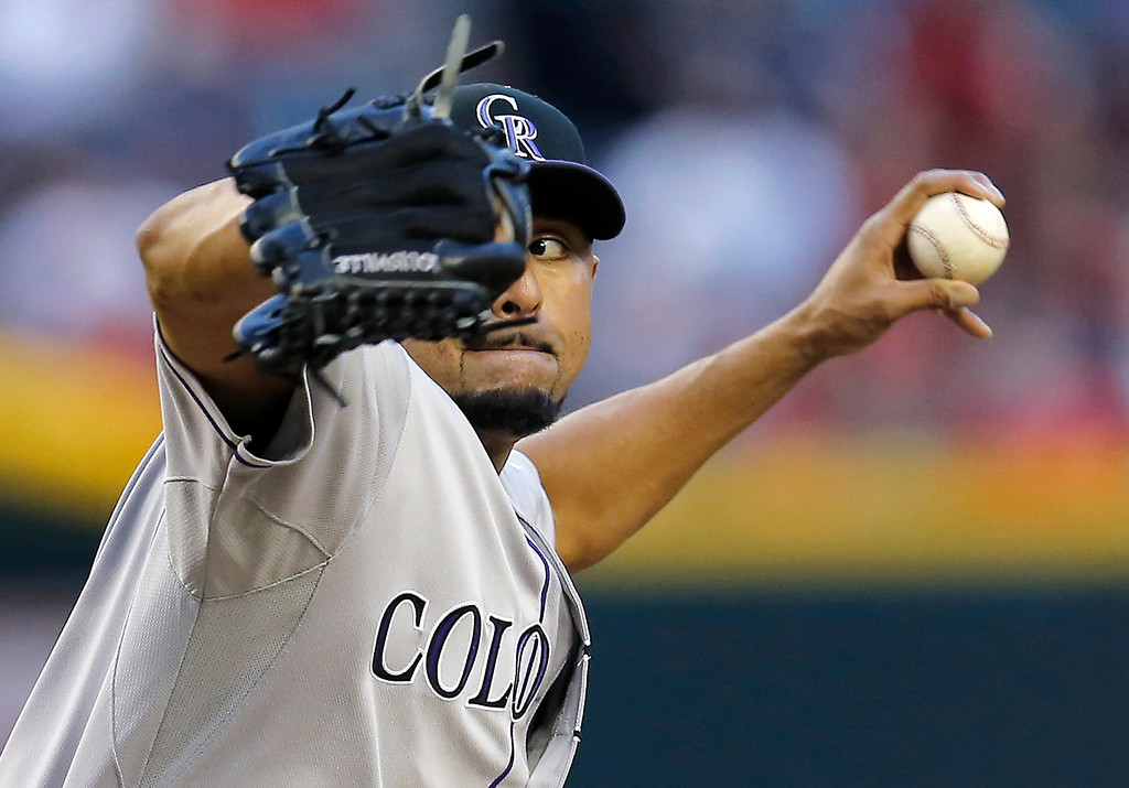 . Colorado Rockies pitcher Franklin Morales throws against the Arizona Diamondbacks during the first inning of a baseball game on Monday, April 28, 2014, in Phoenix. (AP Photo/Matt York)