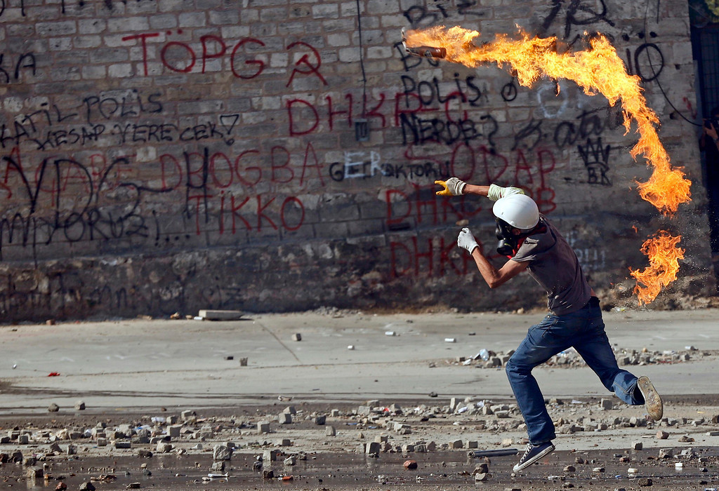 . A protester throws a petrol bomb at riot police during a protest at Taksim Square in Istanbul June 11, 2013.     REUTERS/Murad Sezer