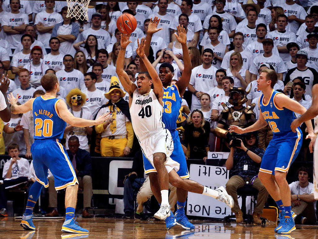 . Colorado\'s Josh Scott throws a pass after a rebound during the first half of an NCAA college basketball game against UCLA, in Boulder, Colo., Thursday, Jan. 16, 2014. (AP Photo/Brennan Linsley)