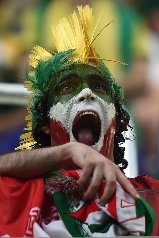 . An Iranian fan cheers for his team before the start of the Group F football match between Iran and Nigeria at the Baixada Arena in Curitiba during the 2014 FIFA World Cup on June 16, 2014.  AFP PHOTO / JEWEL SAMAD/AFP/Getty Images