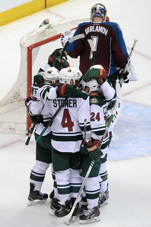 . Kyle Brodziak (21) of the Minnesota Wild celebrates his 4-2 goal as Semyon Varlamov (1) of the Colorado Avalanche stands in the crease during the second period of action. The Colorado Avalanche hosted the Minnesota Wild in the first round of the NHL playoffs at the Pepsi Center on Thursday, April 17, 2014. (Photo by Karl Gehring/The Denver Post)
