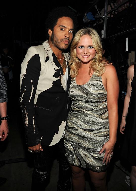 . Lenny Kravitz, left, and Miranda Lambert pose backstage at the 2013 CMT Music Awards at Bridgestone Arena on Wednesday, June 5, 2013, in Nashville, Tenn. (Photo by Frank Micelotta/Invision/AP)