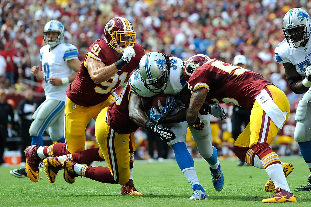 . LANDOVER, MD - SEPTEMBER 22:  Joique Bell #35 of the Detroit Lions rushes for a touchdown in the first quarter during a game against the Washington Redskins at FedExField on September 22, 2013 in Landover, Maryland.  (Photo by Patrick McDermott/Getty Images)
