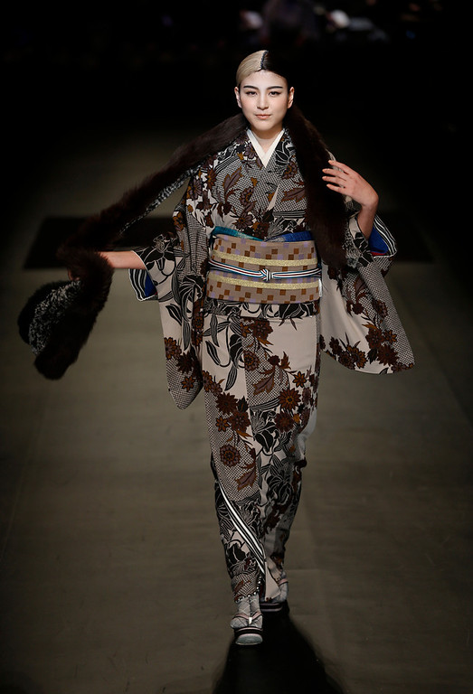 . A model displays a creation from Japanese designer Jotaro Saito\'s 2014-2015 Autumn/Winter collection at Tokyo Fashion Week  in Tokyo, Wednesday, March 19, 2014. (AP Photo/Shizuo Kambayashi)