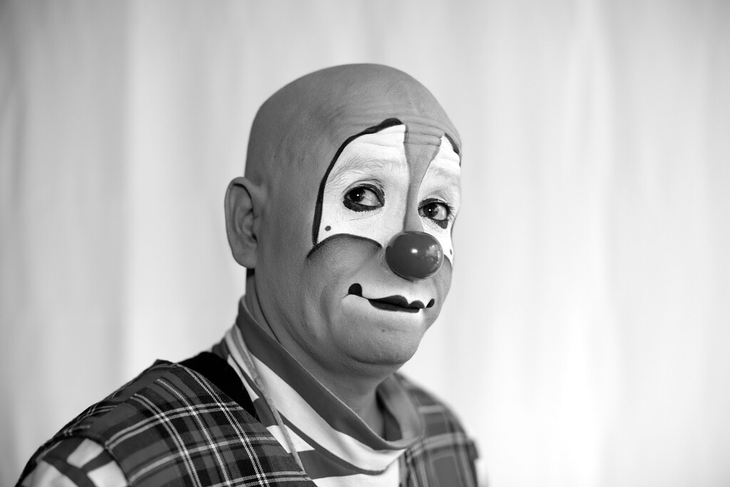 . Mexican clown Renato Prieto y Aguado poses for a portrait at the 17th International Clown Convention in Mexico City, Tuesday, Oct. 22, 2013. Despite their elaborate face paint, weird wigs and rubber noses of different sizes, the clowns reveal a slice of the humanity they seek to entertain: happy and sad, pensive and exuberant, playful and macabre.  (AP Photo/Dario Lopez-Mills)