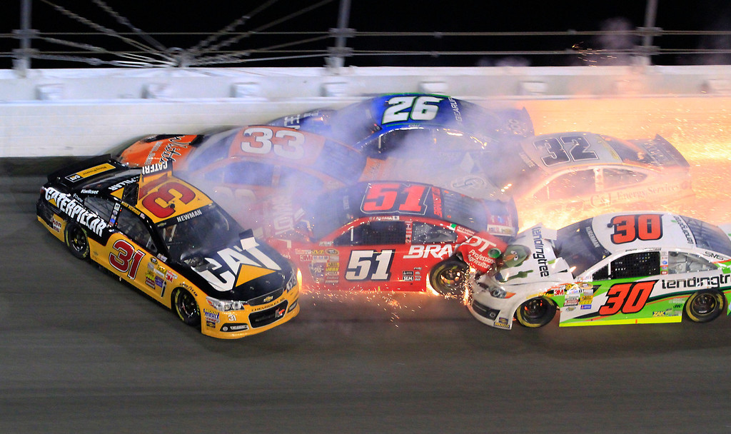 . Ryan Newman (31), Brian Scott (33), Cole Whitt (26), Justin Allgaier (51), Terry Labonte (32) and Parker Kligerman (30) wreck in a multi-car crash in the Daytona 500 NASCAR Sprint Cup Series auto race at Daytona International Speedway in Daytona Beach, Fla., Sunday, Feb. 23, 2014. (AP Photo/Mike Troxell)