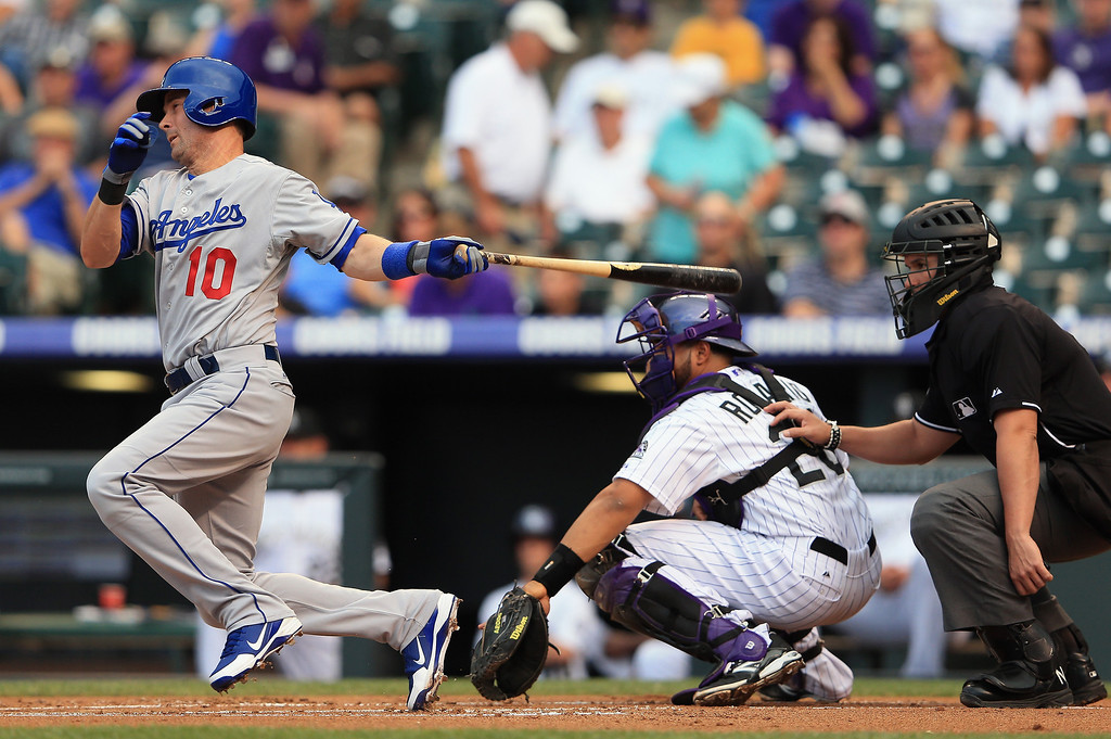 . Third baseman Michael Young #10 of the Los Angeles Dodgers hits into a double play against the Colorado Rockies in the first inning at Coors Field on September 3, 2013 in Denver, Colorado.  (Photo by Doug Pensinger/Getty Images)