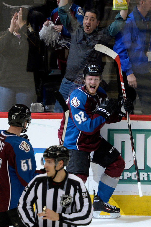 . Gabriel Landeskog (92) of the Colorado Avalanche celebrates his 3-1 goal against the Minnesota Wild with teammate Andre Benoit (61) during the second period.  (Photo by AAron Ontiveroz/The Denver Post)