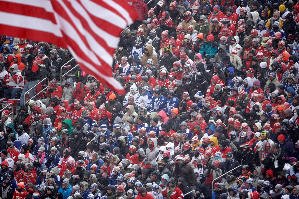 . Hockey fans pack Michigan Stadium as they watch the first period of the Winter Classic outdoor NHL hockey game between the Detroit Red Wings and the Toronto Maple Leafs in Ann Arbor, Mich., Wednesday, Jan. 1, 2014. (AP Photo/Carlos Osorio)