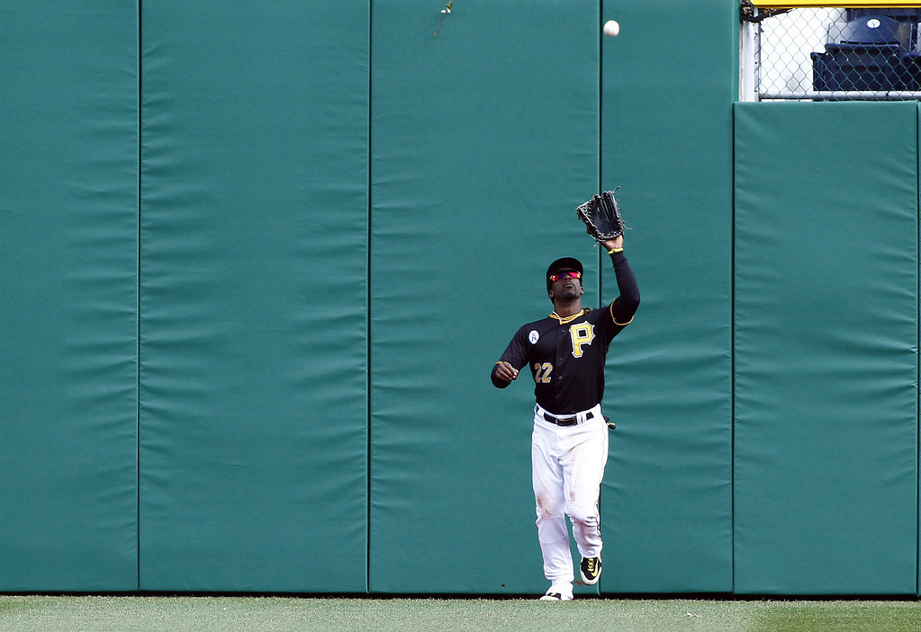 . Andrew McCutchen #22 of the Pittsburgh Pirates catches a fly ball against the Chicago Cubs during the opening day game on April 1, 2013 at PNC Park in Pittsburgh, Pennsylvania.  The Cubs defeated the Pirates 3-1.  (Photo by Justin K. Aller/Getty Images)