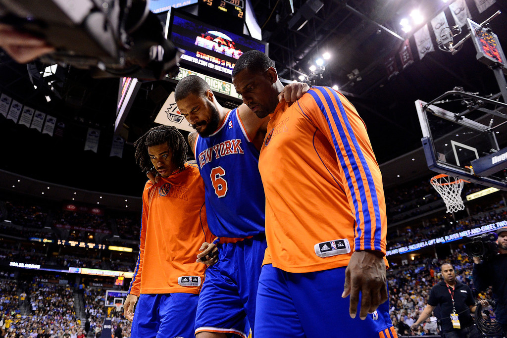 . DENVER, CO - MARCH 13: Tyson Chandler (6) of the New York Knicks is helped off the court by teammates after getting injured against the Denver Nuggets during the first half of action. The Denver Nuggets play the New York Knicks at the Pepsi Center. (Photo by AAron Ontiveroz/The Denver Post)