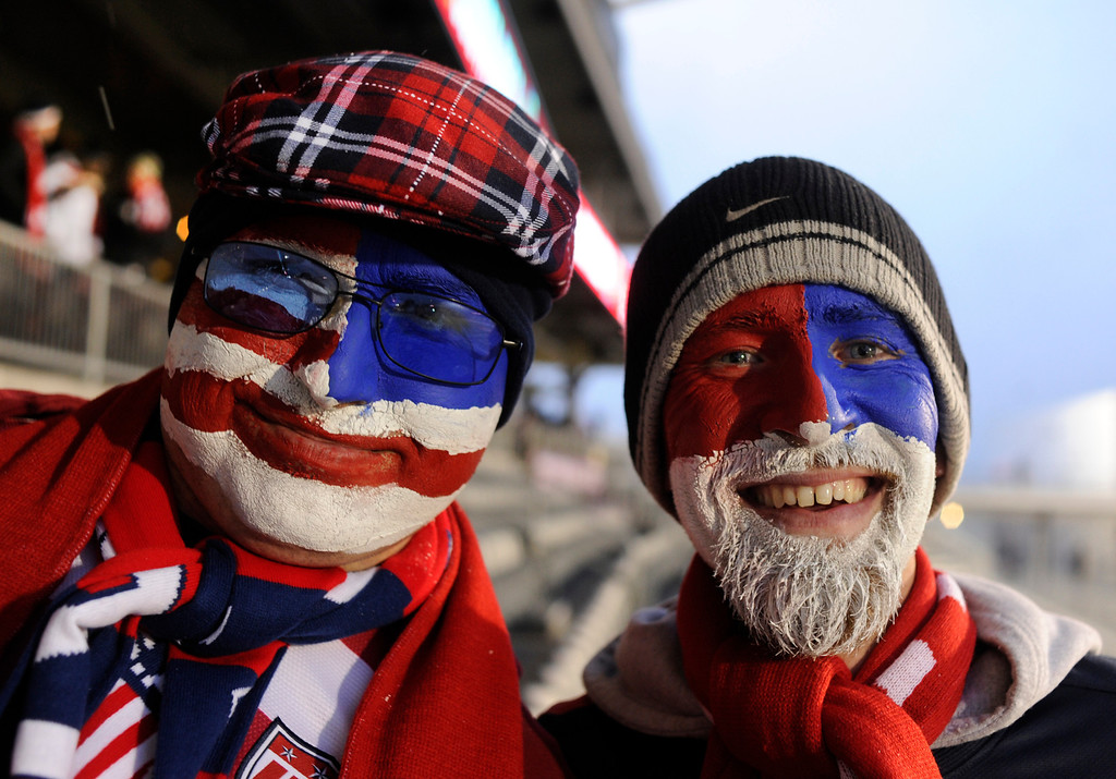 . COMMERCE CITY, CO. - MARCH 22: Soccer fans George Goertzen, left, and Russell Johansen, right, came with painted faces Friday night. The U.S. Men\'s National Soccer Team hosted Costa Rica Friday night, March 22, 2013 in a FIFA World Cup qualifier at Dick\'s Sporting Goods Park in Commerce City.  (Photo By Karl Gehring/The Denver Post)