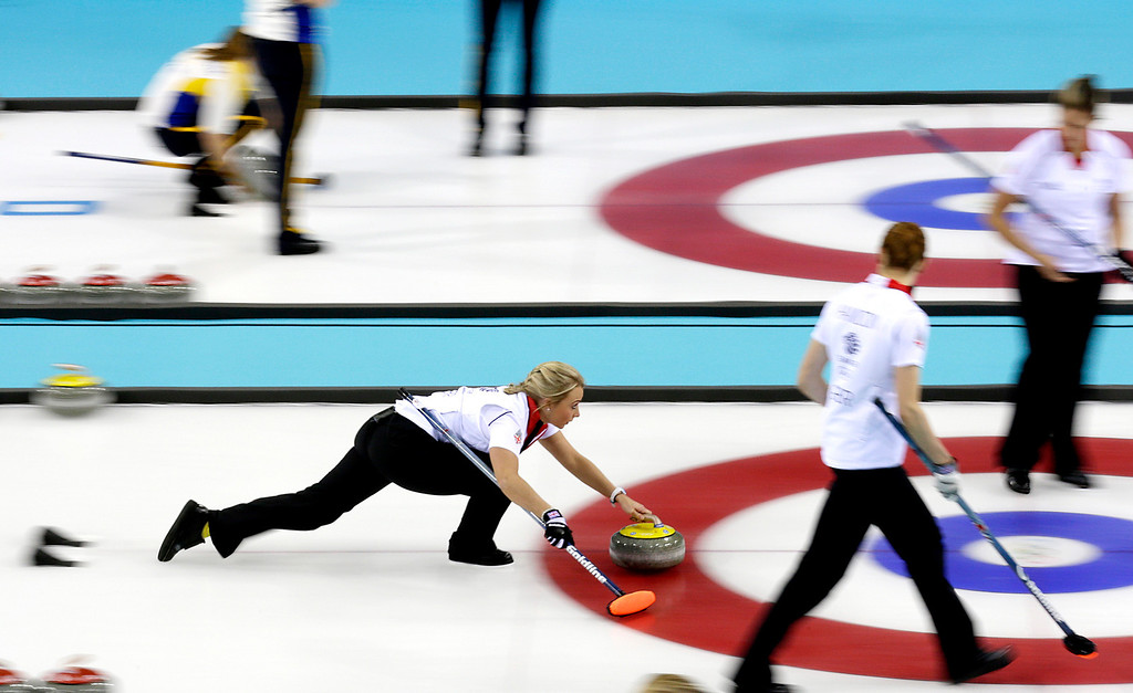 . Britain\'s Anna Sloan, left, delivers the rock during the women\'s curling competition against China at the 2014 Winter Olympics, Thursday, Feb. 13, 2014, in Sochi, Russia. (AP Photo/Wong Maye-E)