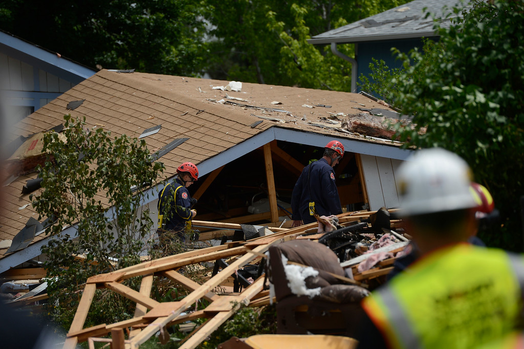 . Members of the North Area Tech Rescue Team, walk through debris scattered from a house explosion on the 9300 block of Ingalls Street in Westminster, Colorado, Thursday afternoon June 13, 2013.  (Photo By Andy Cross/The Denver Post)